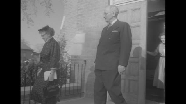 stockvideo's en b-roll-footage met ms police officer stands guard outside trinity episcopal church with hands on hips / officer holds church door open as former us president harry... - margaret truman