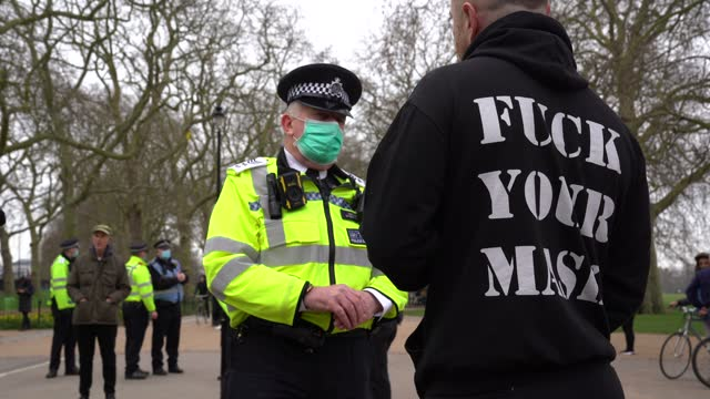 """police officer talks to a anti mask wearer on march 20, 2021 in london, england. """"world wide rally for freedom"""" protests, with apparent links to the... - fear stock videos & royalty-free footage"""