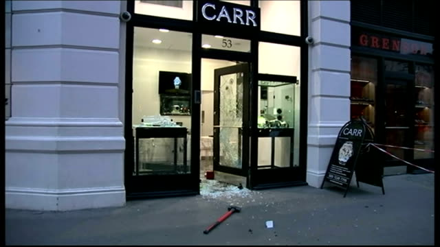 Police officer threatened with machete during raid on luxury jewellers in London ENGLAND London Liverpool Street EXT Smashed door of Carr Watches and...