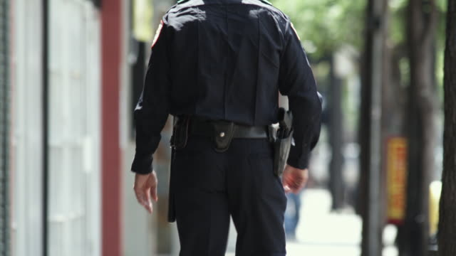 ms police officer walking down sidewalk / dallas, texas, usa - see other clips from this shoot 1606 stock videos & royalty-free footage