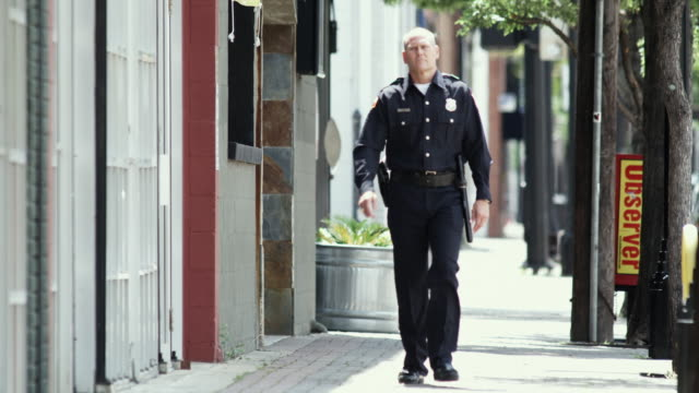 ws police officer walking down sidewalk / dallas, texas, usa - see other clips from this shoot 1606 stock videos & royalty-free footage