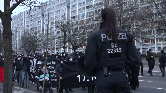 """stockvideo's en b-roll-footage met police officer watches on, as people chant holding a black banner stating """"geboren am 17 november"""" as around 250 protesters march through the... - geboren in"""