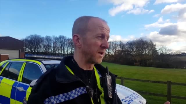 A police officer who clung on to a crashed van to stop it falling from a bridge on to a road below has said 'I was just doing my job' Pc Martin...