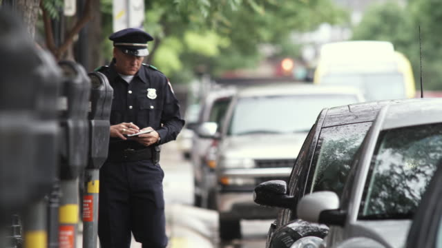 ms police officer writing parking tickets / dallas, texas, usa - see other clips from this shoot 1606 stock videos & royalty-free footage