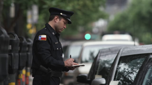 ms pan td police officer writing parking tickets / dallas, texas, usa - see other clips from this shoot 1606 stock videos & royalty-free footage