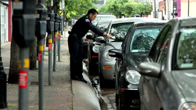 ws police officer writing parking tickets / dallas, texas, usa - see other clips from this shoot 1606 stock videos & royalty-free footage