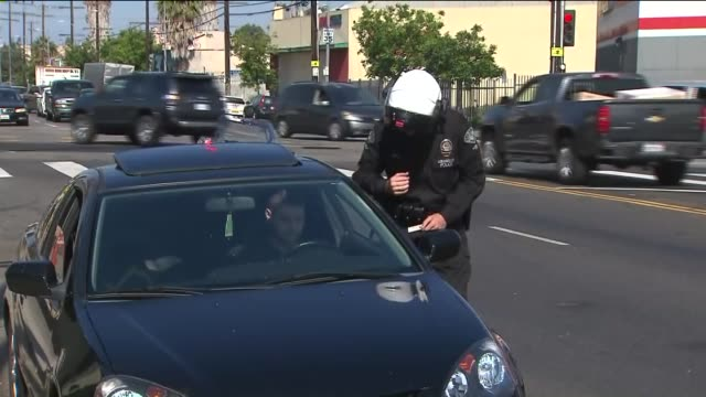 police officer writing ticket. - los angeles police department stock videos & royalty-free footage