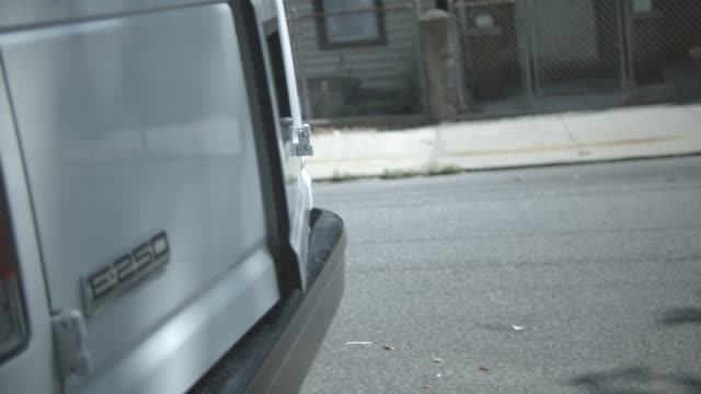 CU, SHAKY, Police officers aiming gun getting out of police van, Staten Island, New York City, New York State, USA