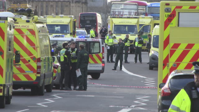 police officers and ambulances lined up on westminster bridge at general views - westminster attack on march 22, 2017 in london, england. - westminster bridge stock videos & royalty-free footage