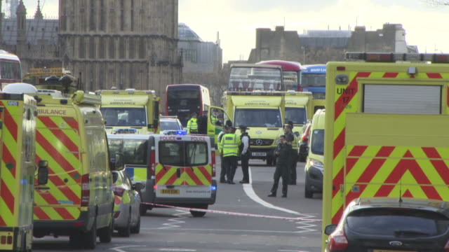 police officers and ambulances lined up on westminster bridge at general views - westminster attack on march 22, 2017 in london, england. - terrorism stock videos & royalty-free footage