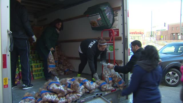 wgn police officers and church members put together bags of food so that others can have meals on thanksgiving people unloading russet potatoes from... - donation box stock videos & royalty-free footage