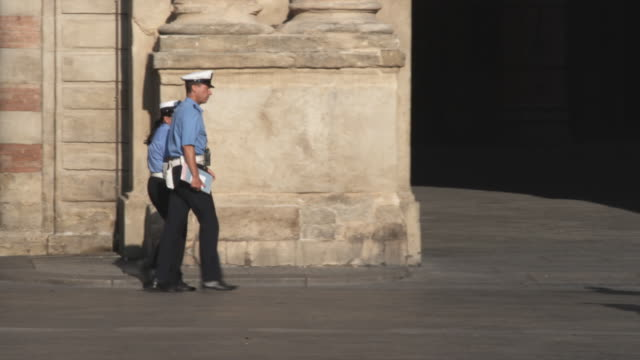 WS PAN Police officers and tourists in street / Bologna, Italy