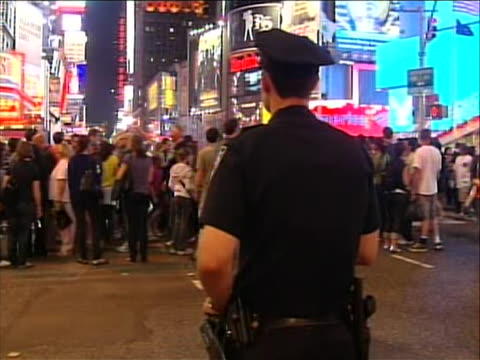 police officers are redirecting pedestrian traffic because times square is shut down and evacuated because a bomb was found in an abandoned car there... - crime or recreational drug or prison or legal trial stock videos & royalty-free footage