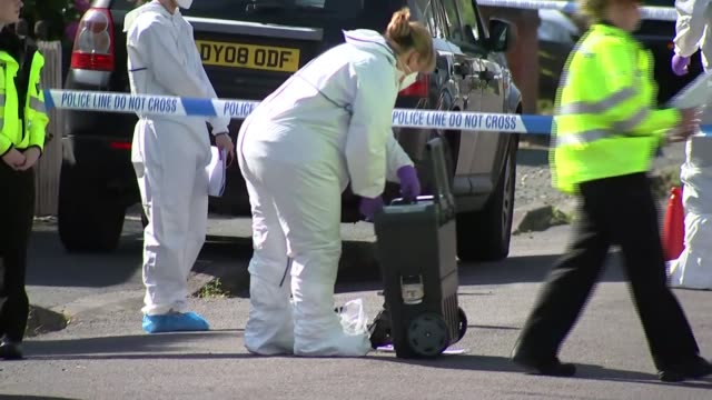 Police officers at incident scene ENGLAND Shropshire Telford EXT General views of forensic officers police officers and police tape cordons at...