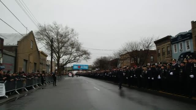 Police officers attend the funeral of slain New York City Police Officer Wenjian Liu who was killed with his partner Rafael Ramos on 20 December by a...