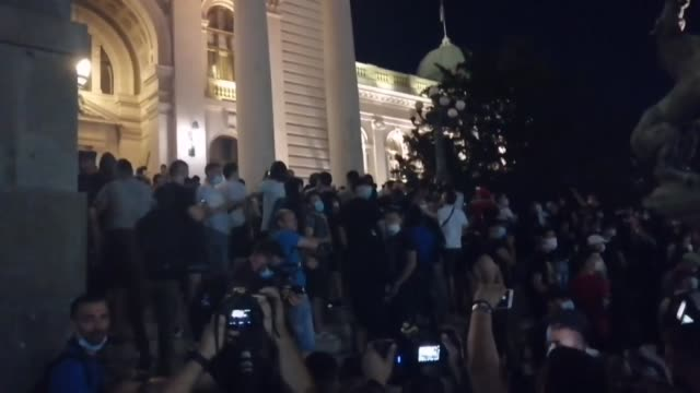 police officers block the entrance to serbia's national assembly building in belgrade on july 10 after clashes broke out during a demonstration... - serbia stock videos & royalty-free footage