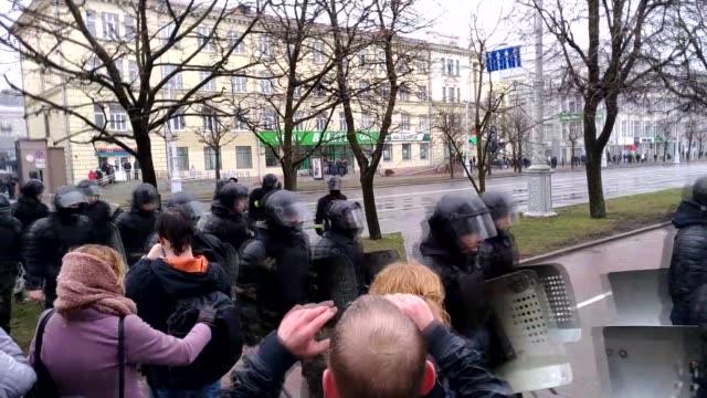 Police officers block the road during an unauthorized demonstration in Minsk Belarus on March 25 2017