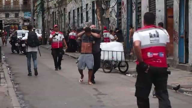 police officers carry out an operation to combat drug trafficking in lapa, one of the main tourist attractions in rio de janeiro downtown, on... - drug trafficking stock videos & royalty-free footage