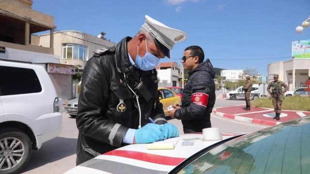 police officers check documents of drivers following a limited curfew order by the government in tunis bizerte district on march 28, 2020. streets of... - tunisia stock videos & royalty-free footage
