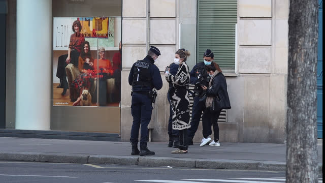 police officers check travel certificates on the second day of isolation on october 31, 2020 in paris, france. france imposed another national... - france stock videos & royalty-free footage