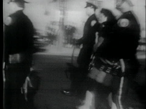 police officers escort a caucasian mother and her daughter to school - 1954 stock videos & royalty-free footage