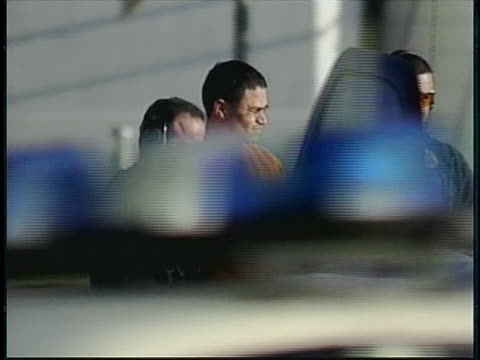 police officers escort a shackled jose padilla to a police car in miami, fl; he has been found guilty of providing support for violent holy wars. - religion or spirituality stock videos & royalty-free footage