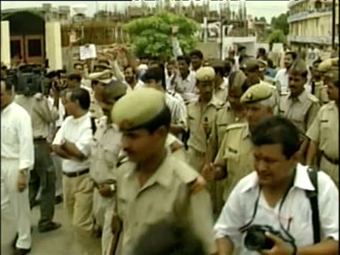 Police officers escort protestors marching in protest against visit of Pakistani Leader General Pervez Musharraf Agra Jul 2001