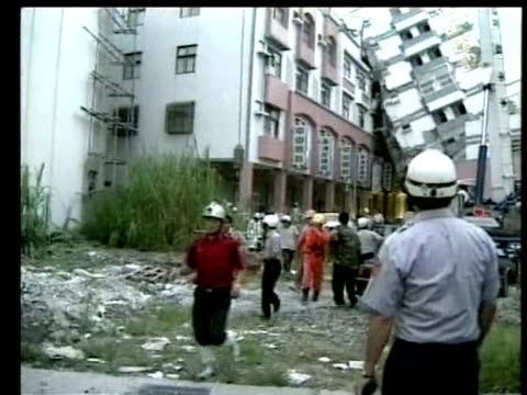 police officers evacuate people from building following earthquake chi chi 23 september 1999 - taiwan stock videos & royalty-free footage