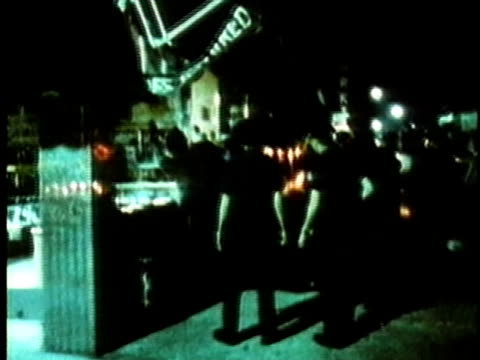 police officers frisking black men lined up against store window on city street at night/ usa/ audio - autorità video stock e b–roll