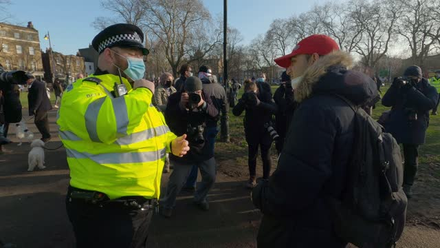 police officers give a warning to a protester on clapham common during the anti-lockdown demonstration on january 9, 2021 in london, england. chief... - danger stock videos & royalty-free footage