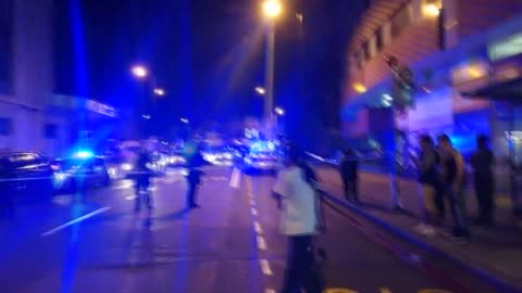 police officers guard a road leading to finsbury park mosque after several people were injured on june 19, 2017 when a vehicle ran down pedestrians... - terrorism stock videos & royalty-free footage