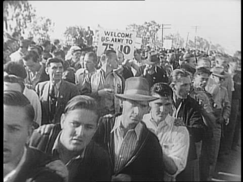 vidéos et rushes de police officers guarding gates outside north american aviation plant / views of striking workers marching in chain formation / group of striking... - 1941