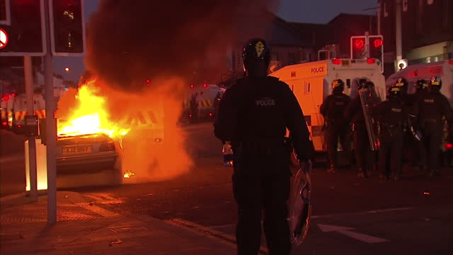 29 police officers have been injured in northern ireland as they attempted to keep loyalist and republican demonstrators apart and as tom parmenter... - belfast stock videos & royalty-free footage