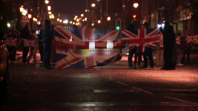 vídeos de stock e filmes b-roll de police officers have fired plastic bullets after coming under attack from petrolbomb throwing rioters in northern ireland trouble broke out last... - belfast
