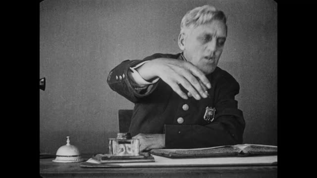 stockvideo's en b-roll-footage met 1917 police officers herd men (fatty arbuckle & al st john) into jail cell - 1917