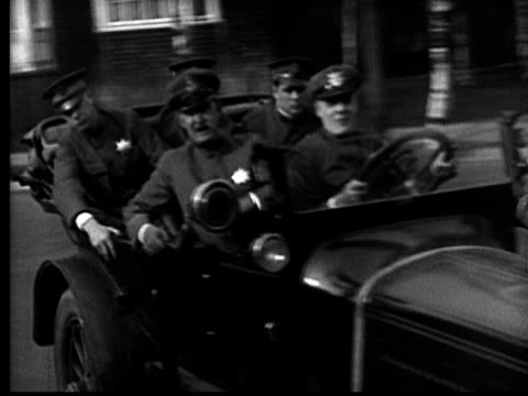 ms, b&w, police officers in car, driving fast through city, thugs scrambling underground, 1920's  - verfolgung stock-videos und b-roll-filmmaterial