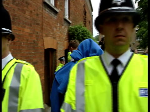 stockvideo's en b-roll-footage met police officers in court on child porn charges itn bury st edmunds magistrates court detective constable brian stevens led along from police van to... - kinderporno