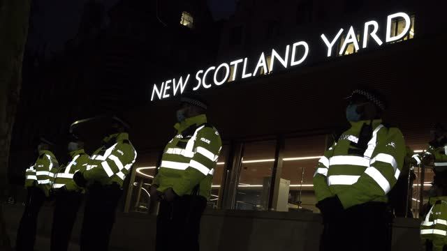 police officers in protective face masks stand guard outside new scotland yard several as thousand people defy covid regulations and march across... - westminster bridge stock videos & royalty-free footage
