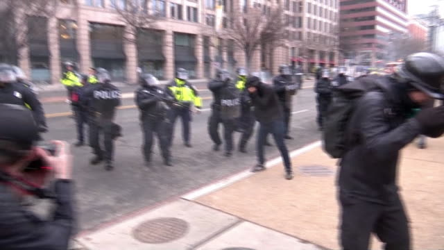 police officers in riot gear and reflector vests fire pepper spray on protesters in street after trump's inauguration on january 20th, 2017 in... - reflector stock videos & royalty-free footage