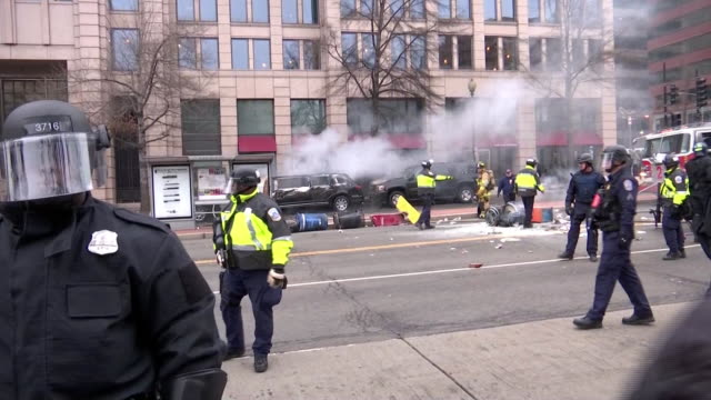 police officers in riot gear and reflector vests stand in a row and patrol street after trump's inauguration on january 20th, 2017 in washington d.c.... - reflector stock videos & royalty-free footage