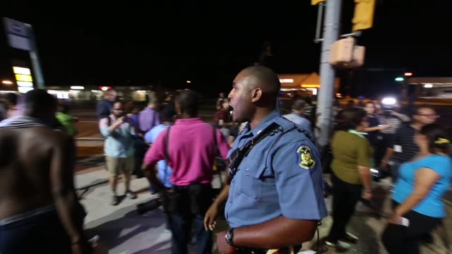 Police officers intervene demonstrators during the ongoing protests over the death of 18yearold Michael Brown on West Florissant Avenue in Ferguson...