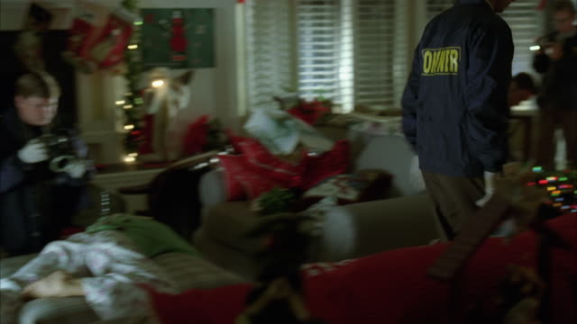 Police officers investigating a crime scene during Christmas.