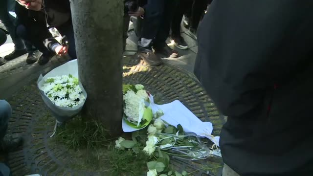 police officers lay flowers at the scene of thursday's attack which cost one officer his life on the champs elysees in paris - thursday stock videos and b-roll footage