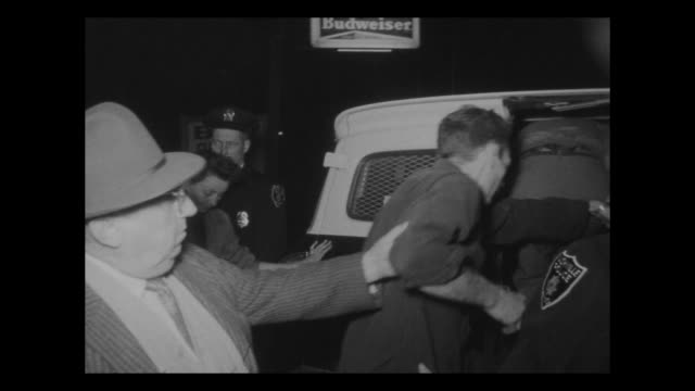 police officers lead two men and woman are handcuffed together into police van. - festnahme stock-videos und b-roll-filmmaterial