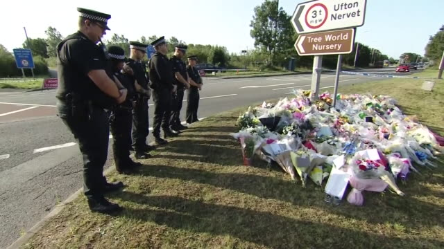 police officers leaving floral tributes near the site where pc andrew harper was murdered - run over stock videos & royalty-free footage