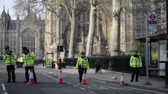 police officers of the metropolitan police stand guard at a cordoned off section outside the palace of westminster, commonly know as the houses of... - westminster bridge stock videos & royalty-free footage