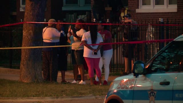 WGN Police officers on scene after shooting at W North Ave N Major Ave in Chicago on July 4 2017 Over 100 hundred people were shot 15 fatally in...