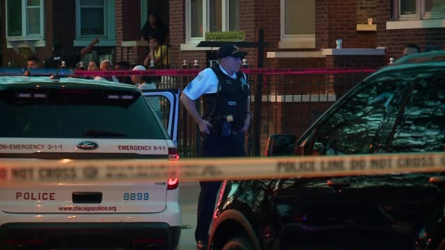wgn police officers on scene after shooting at w north ave n major ave in chicago on july 4 2017 over 100 hundred people were shot 15 fatally in... - shooting crime stock videos & royalty-free footage