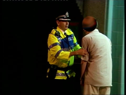 Police officers patrolling near pub Police officer along holding beer glasses Barmaid pulling pint Drinks on bar Beer poured into glass