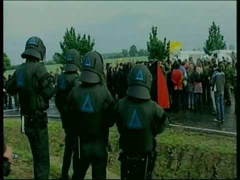 police officers provide security during protests at the 2007 g8 summit in rostock laage germany - (war or terrorism or election or government or illness or news event or speech or politics or politician or conflict or military or extreme weather or business or economy) and not usa stock-videos und b-roll-filmmaterial